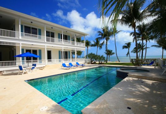 Large private estate ocean front home with beach side pool