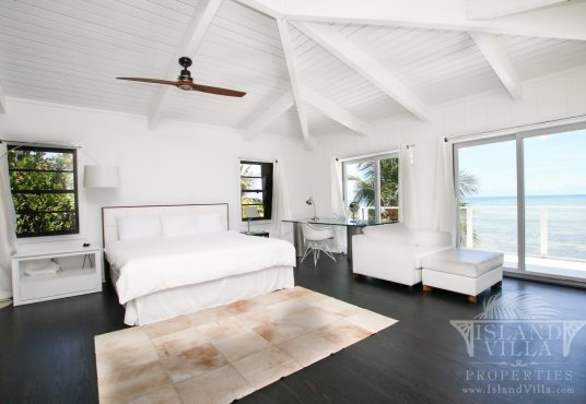 Master bedroom with ocean views and private balcony