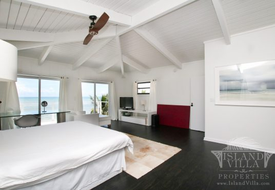 Large master suite with private balcony and ocean views