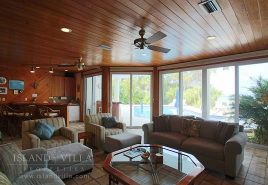 wall to wall windows in the living room at osprey bay vacation rental