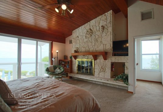 master bedroom suite with wall to wall sliding glass doors