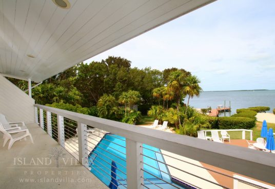second floor master suite balcony overlooking the pool and florida bay