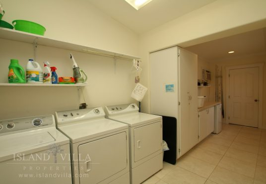 large laundry and fishing tackle room with it's own seperate entrance