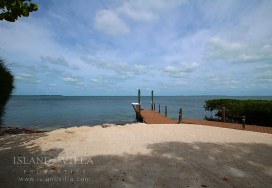boat dock and beach area overlooking florida bay