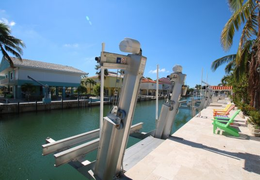 boat lift and boat dock on canal front property in florida keys