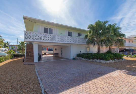 gated and fenced canal front vacation home located on plantation key