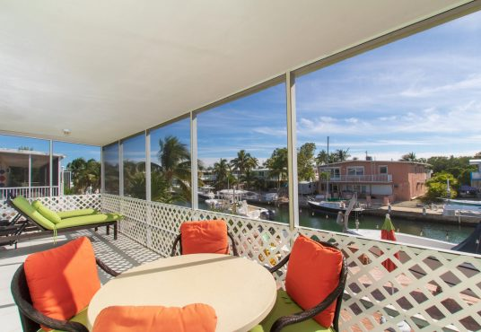 screened in patio overlooking the canal