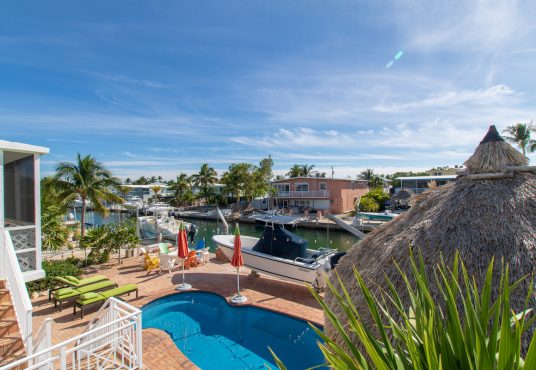 canal front vacation rental with pool and tiki hut