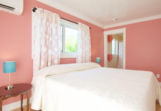 coral pink bedroom with ensuite bath