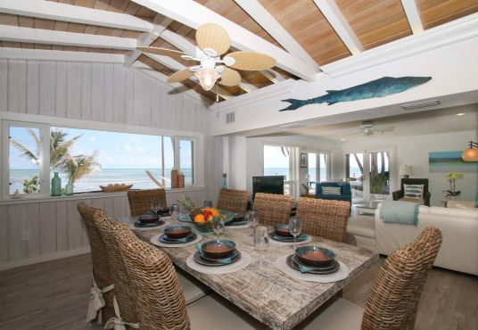 open concept dinning and living area with gorgeous views of the turquoise water