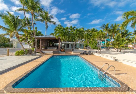 oceanfront pool with large sun deck and covered cabana